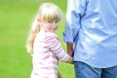 Picture of girl holding dad's hand, looking back.